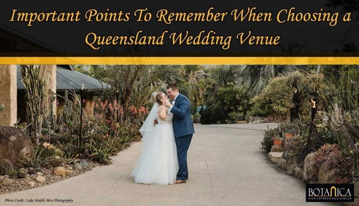 banner image of a newly-wedded couple dancing in the middle of garden wedding venue of Villa Botanica waterfront Queensland wedding venue